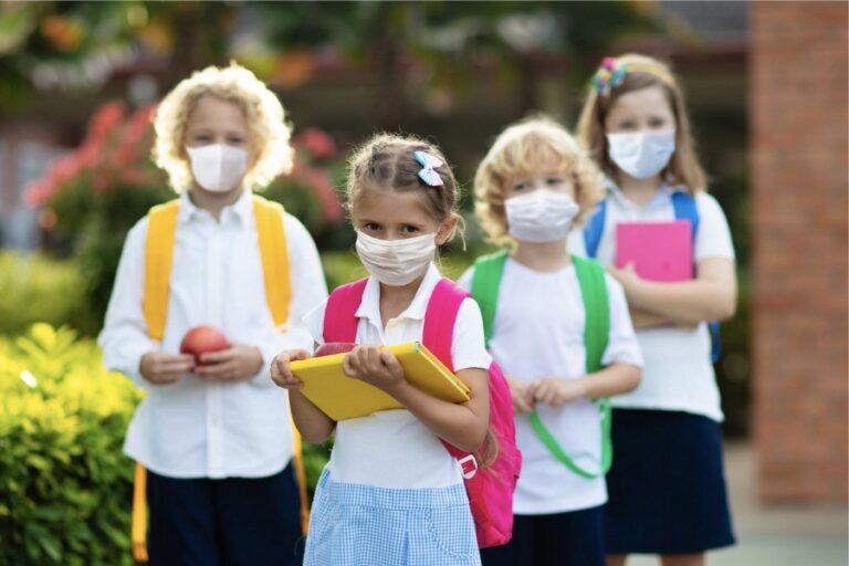Children at school wearing PPE face coverings