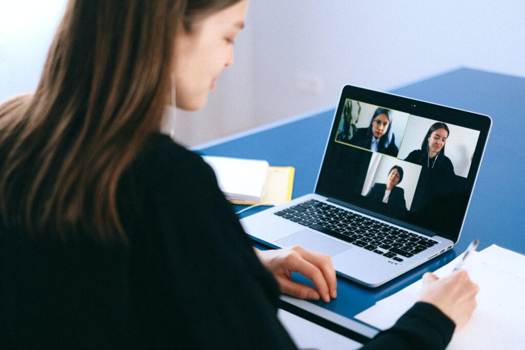 woman in front of laptop in a video conference