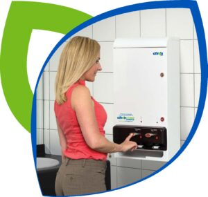 image of woman using feminine hygiene vending machine