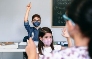 students with masks on in class