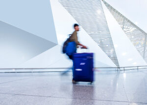 Man walks with blue bag in Hygienic Airport