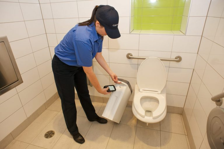 Citron Hygiene staff checking sanitary waste disposal units