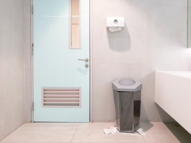 image of washroom with silver garbage can