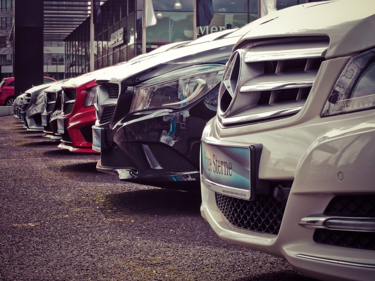 Row of Mercedes-Benz cars parked at garage