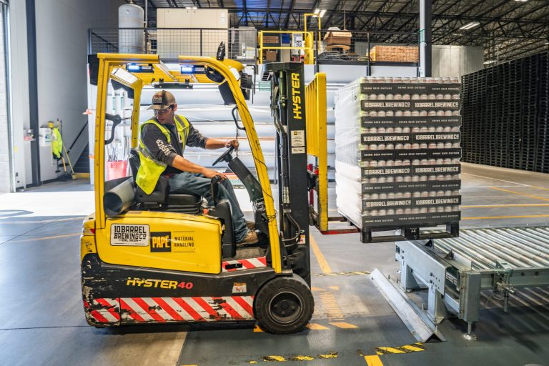 Man driving forklift vehicle in a Distribution Center