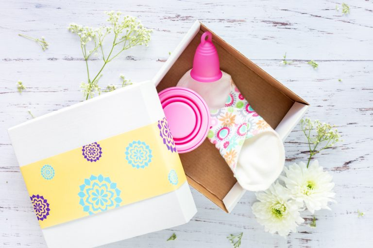 Pink menstrual cup in a box