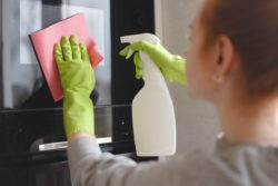 woman cleaning using disinfectant